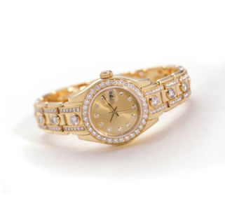 Diamond and gold watch